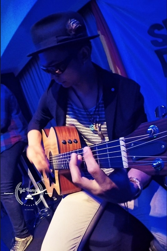 yat hamzah flamboyant guitarist ska jazz blues reggae rocksteady acoustic guitar taylor men rudeboy fashion style swinging new york hat fedora stringy