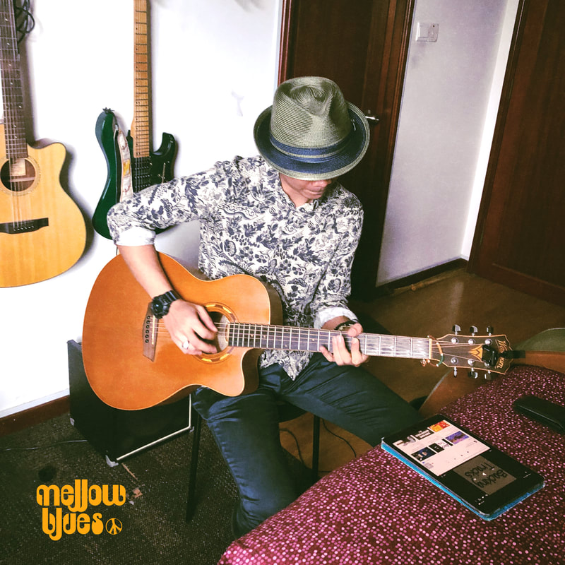 Mellow Blues Acoustic Guitarist Singer Songwriter Blues Folk Indie Rock n Roll Men Summer Blues Music Fashion Style Straw Dasmarca Trilby Hat Guitar Lessons in Singapore Guitar Teacher washburn acoustic guitar