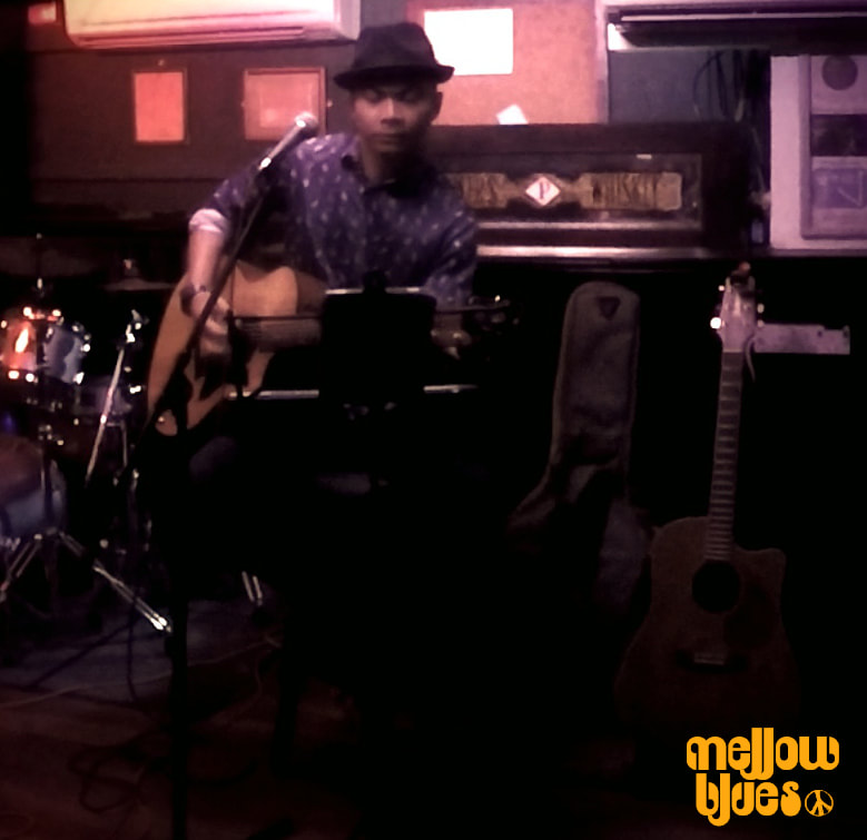 Mellow Blues Blues Folk Indie Rock n Roll Acoustic Guitarist Singer Songwriter Artist Musician Acoustic Guitar Lessons in Singapore Men Smart Casual Trilby Stingy Brim Hat Blues Folk Musician Summer Fashion Style