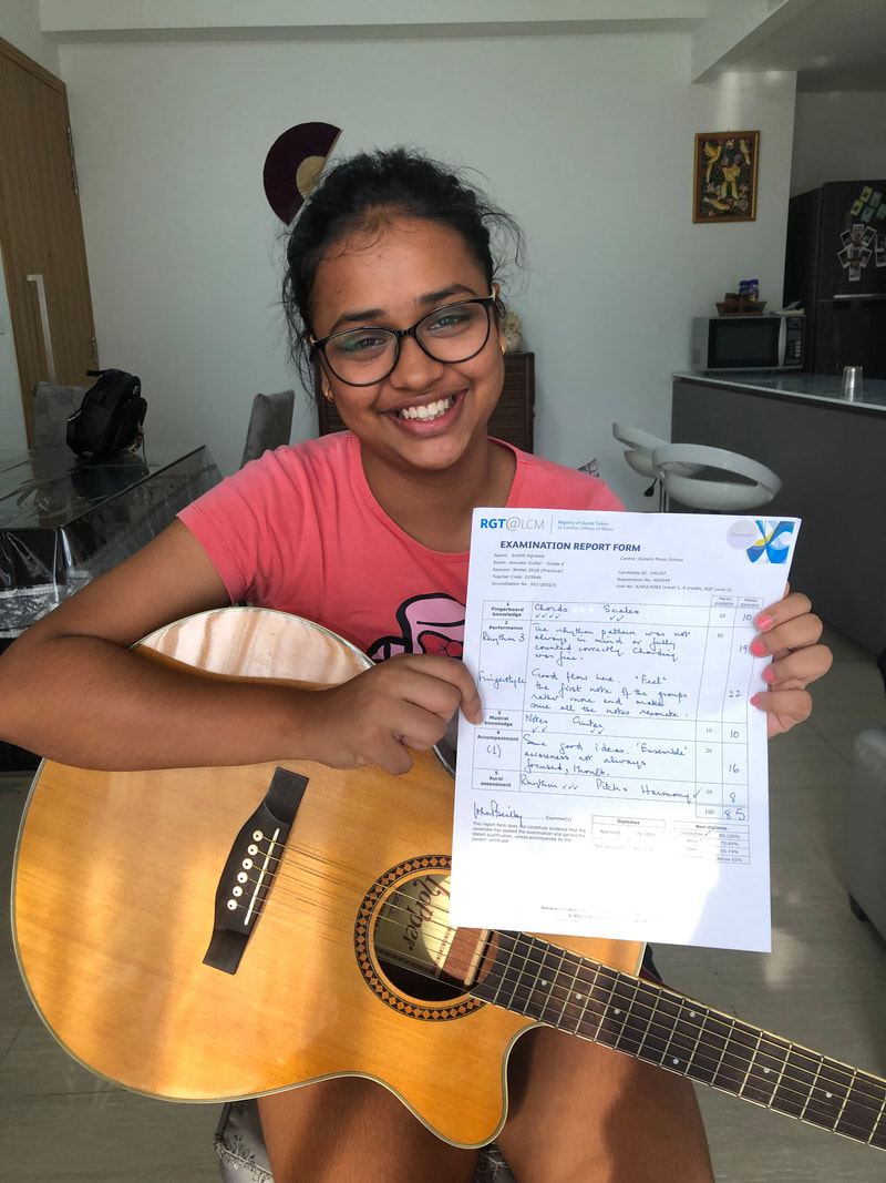 Mellow Blues Guitar Lessons in Singapore LCM Acoustic Guitar Grade 2 Student
