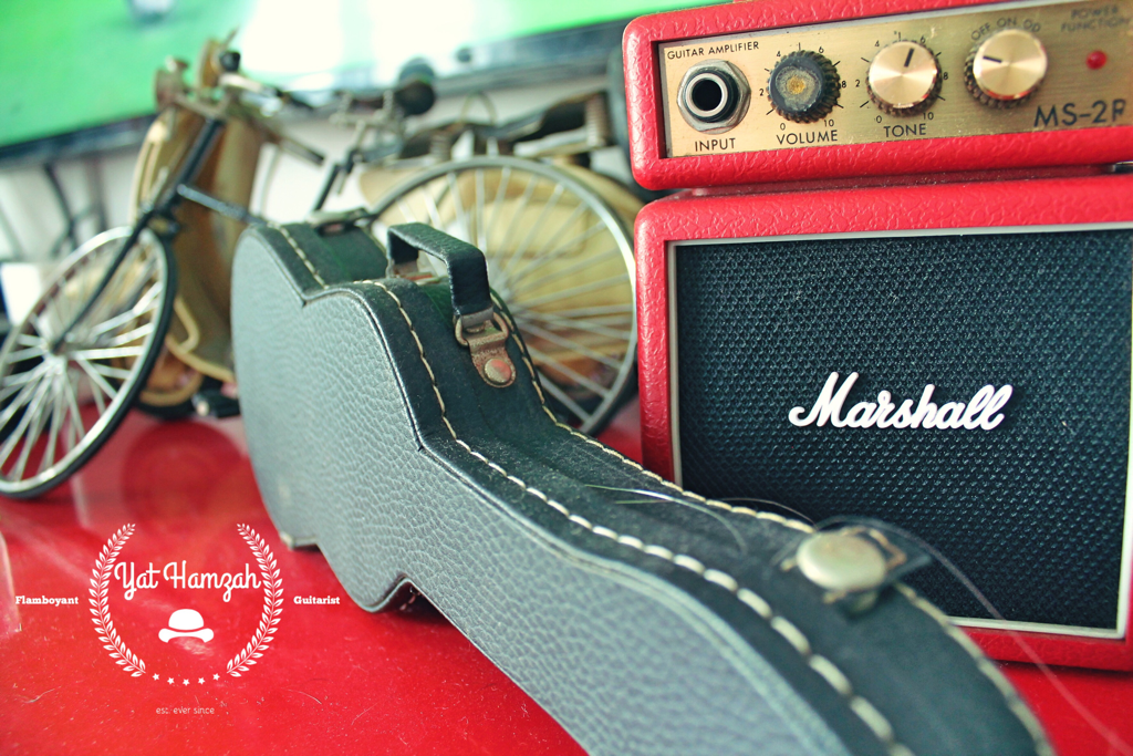 Marshall amp and toy hardcase guitar taken with DSLR camera canon